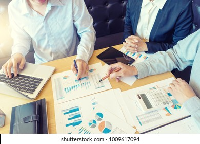 Group of teamwork 3 businessman and woman in the meeting work to analysis marketing data concept business discussion three person
