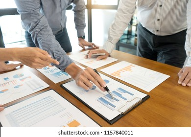 Group of teamwork businessman and woman in the meeting work to analysis marketing data concept business discussion