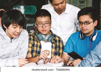 Group of teen high school students doing their homework