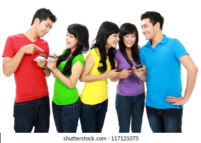Group of Teenage Friends hold their mobile phones