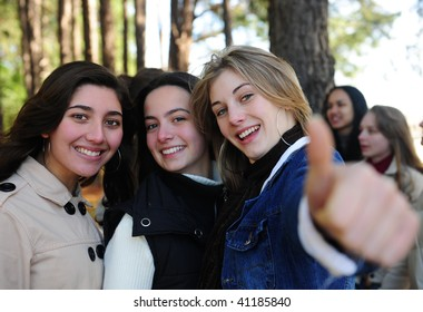 group of teenage girls on vacation during a trip in the forest