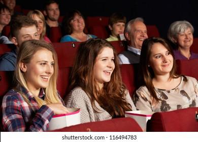Group Of Teenage Girls Watching Film In Cinema