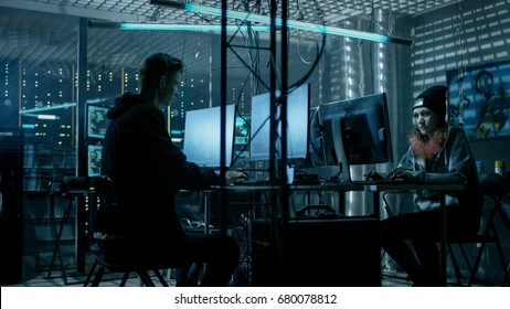 Group of Teenage Hackers Attacking Cyber Security Servers from Their Underground Hideout. Place Has Dark Atmosphere, Multiple Displays, Cables Everywhere.