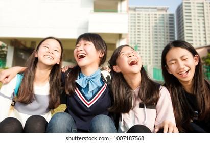 Group Of Teenage Studentsgirls having fun