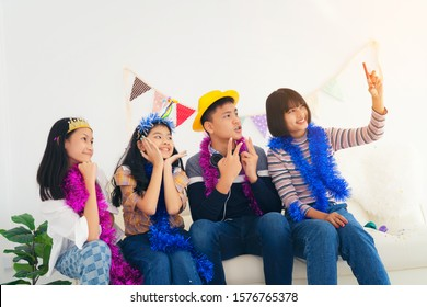 Group Of Teenage Students Posing For Selfie In room after party, student friendship concept