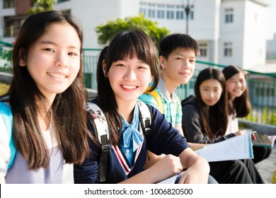 Group Of Teenage Students study in school