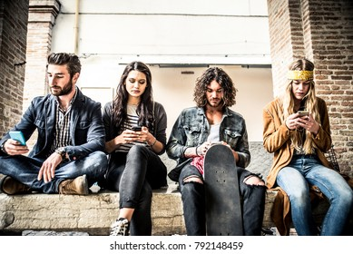 Group of teenagers addicted to their smartphone