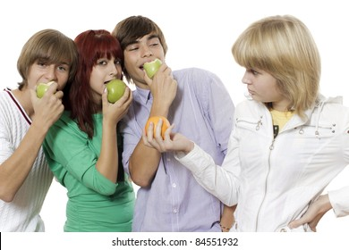 A group of teenagers with bright fruits in hands