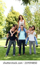 Group of teenagers having fun in a park