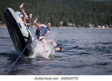 A group of teenagers having fun with a speed boat during the Summer Break in British Columbia, Canada