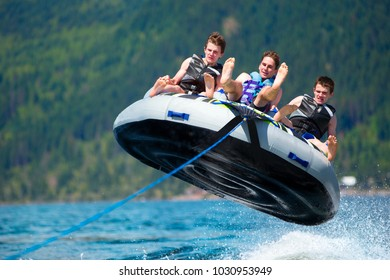 Group of teenagers having fun with a speed boat during the Summer Break in British Columbia, Canada