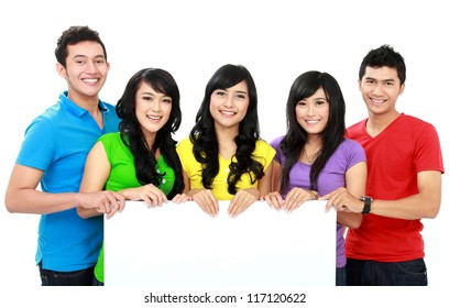group of teenagers hold a white blank space together