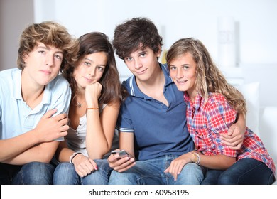 Group of teenagers at home with music player