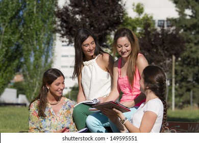 group of teenagers in a park talking
