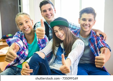 group of teenagers showing gesture OK