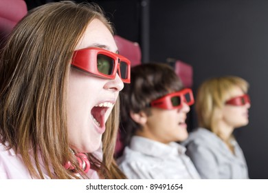 A group of  teenagers sits in the 3-D cinema