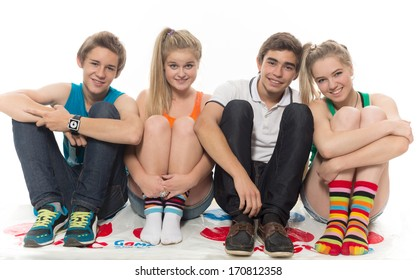The group of teenagers sits on a white background