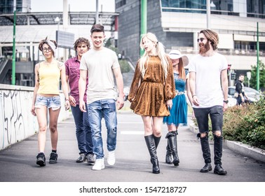 Group of teenagers walking in the city center