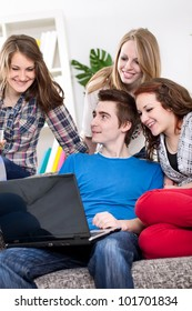 Group of teenagers watching funny clip over the Internet