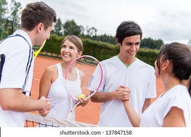 Group of tennis players giving a handshake after a match