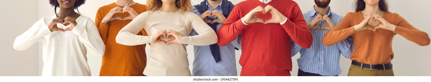 Group of thankful youth and senior citizens showing love and support and sending gratitude. Banner with midsection shot of young and mature people doing heart shape hand gesture