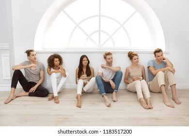 Group therapy session for couples with trust issues. Talk out your problem. Young married couples happy talking while sitting on the therapy session with psychologist. Group of young multi-ethnic