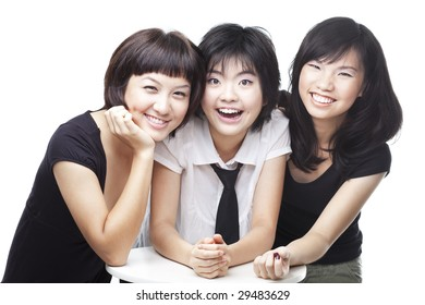 A group of three asian Chinese teenagers friends in college sharing a laughing, happy moment