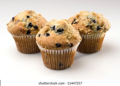Group of Three Blueberry Muffins on White Background