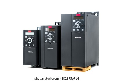 A group of three different sizes and capacities new universal inverter for controlling the electric current and power for industrial on a isolated white background. A frequency converter - rectifier -