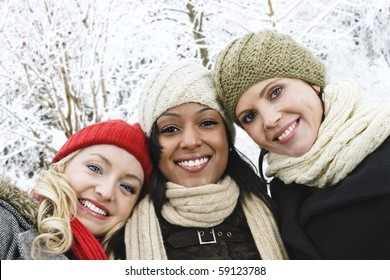 Group of three diverse young girl friends outdoors in winter