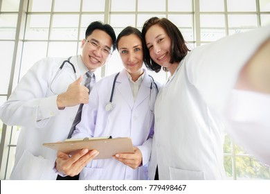Group of three diversity  persons, doctor and assistant, take a selfie photo together with happiness and smiling faces. Concept for successful team.
