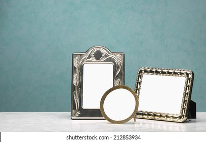 Group of three frames Group of photo frames on the marble table and white pictorial