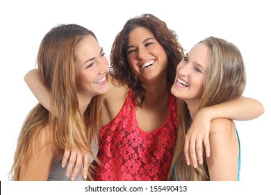Group of three girls hugging happy isolated on a white background