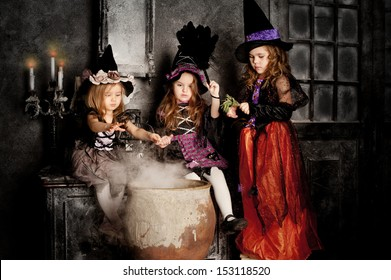 group of three Little Halloween Witch with poison, pot and magic smoke