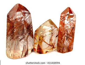 Group of three Mineral quartz  rocks with rutile isolated on a white background