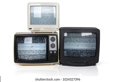 A group of three retro televisions stacked on a white background with static noise displayed on their screens.