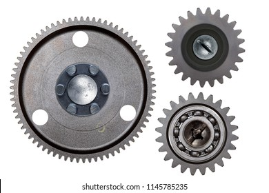 A group of three steel gears isolated on a white background.