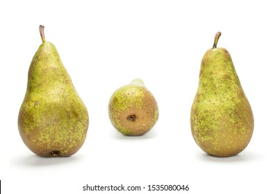 Group of three whole fresh green pear conference two in focus isolated on white background