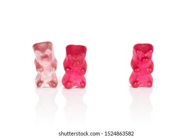 Group of three whole gummy bear isolated on white background