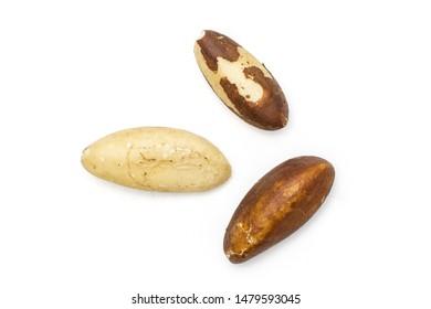 Group of three whole unshelled brazil nut flatlay isolated on white background