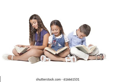 Group of three young caucasian children reading
