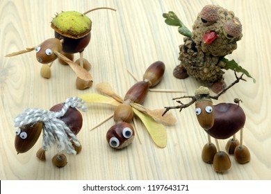 group of tinker figures made of acorn and chestnuts. Dragon fly insect, Owl, horse, man and deers.Autumn time. childhood tinker.