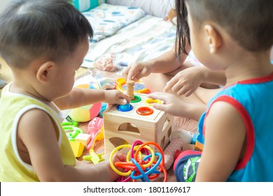 Group of toddlers and children playing colorful toys at kindergarten