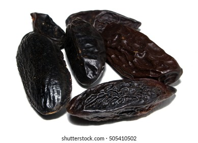 Group of tonka beans (cumaru) seeds with white background