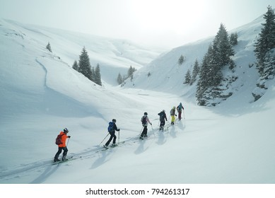 Group of touring skiers. Ski touring in the mountains. Carpathians Mountains, Romania. Winter sports. ski. touring. Group of children with the guide. Group of alpine touring skiers.
