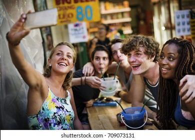 Group of tourist enjoy bucket drinks in Khao San Road Bangkok Thailand walking street
