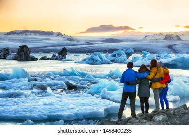Group of tourist looking Beautifull landscape with floating icebergs in Jokulsarlon glacier lagoon at sunset. Location: Jokulsarlon glacial lagoon, Vatnajokull National Park, south Iceland, Europe