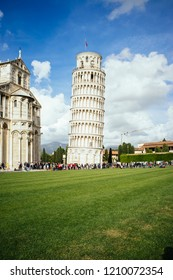 A group of tourist next to the Pisa's Tower in Italy