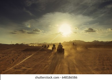 Group of tourist  on ATVs on Egyptian desert. Colored, reworked