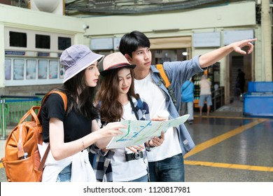 Group of tourist travel in bangkok,Thailand looking location on map and pointing over there.